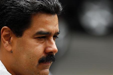 Venezuelan President Nicolas Maduro arrives for a meeting at the national guard headquarters in Caracas October 2, 2013. REUTERS/Jorge Silva