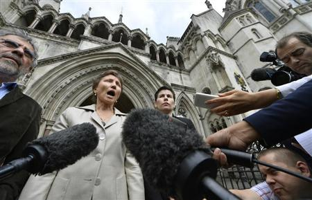 Maria Litvinenko, the widow of former Russian spy Alexander Litvinenko, speaks to members of the media as she leaves the High Court in London July 12, 2013. REUTERS/Toby Melville