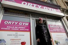 Orty Gym owner Lynda Ellabou poses in font of her new all-women's gym on the outskirts of Paris, in Le Raincy, October 4, 2013. REUTERS/Christian Hartmann