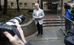 Publicist Max Clifford leaves Southwark Crown Court in London October 4, 2013. REUTERS/Suzanne Plunkett