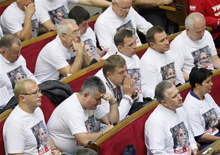 Opposition deputies wear t-shirts in support of imprisoned former Ukrainian Prime Minister Yulia Tymoshenko during a speech by President Viktor Yanukovych at a new session of the Parliament in Kiev September 3, 2013. REUTERS/Gleb Garanich