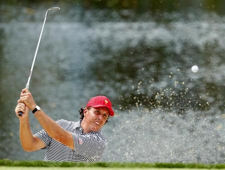 U.S. golfer Phil Mickelson hits from a sand trap on the third hole as he and teammate Keegan Bradley play against the International team of Jason Day of Australia and Graham DeLaet of Canada during the Foursome matches for the 2013 Presidents Cup golf tournament at Muirfield Village Golf Club in Dublin, Ohio October 4, 2013. REUTERS/Chris Keane