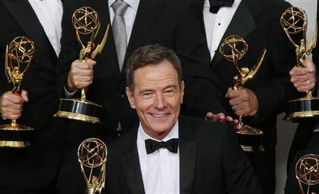 Actor Bryan Cranston from AMC's series ''Breaking Bad'' poses backstage with his award for Outstanding Drama Series at the 65th Primetime Emmy Awards in Los Angeles September 22, 2013. REUTERS/Lucy Nicholson