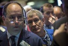 Traders work on the floor of the New York Stock Exchange, October 4, 2013. REUTERS/Brendan McDermid