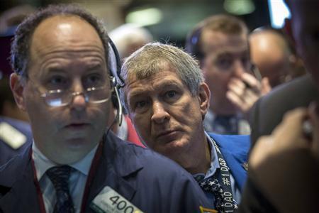 Traders work on the floor of the New York Stock Exchange, October 4, 2013. REUTERS/Brendan McDermid