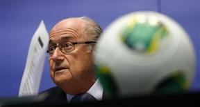 FIFA President Sepp Blatter adjusts his glasses as he addresses the media after a meeting of the executive committee in Zurich October 4, 2013. REUTERS/Arnd Wiegmann