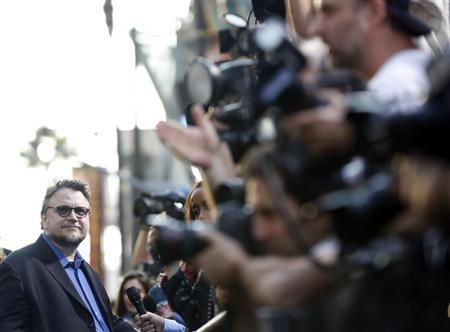 Director Guillermo del Toro is interviewed at the premiere of ''Pacific Rim'' at Dolby theatre in Hollywood, California July 9, 2013. REUTERS/Mario Anzuoni