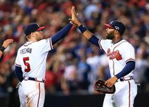 Oct 4, 2013; Atlanta, GA, USA; Atlanta Braves center fielder Jason Heyward (22) celebrates with first baseman Freddie Freeman (5) after defeating the Los Angeles Dodgers in game two of the National League divisional series playoff baseball game at Turner Field. The Braves won 4-3. Mandatory Credit: Daniel Shirey-USA TODAY Sports