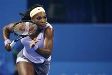 Serena Williams of the U.S. runs to return a shot during her women's singles semi-final match against Agnieszka Radwanska of Poland at the China Open tennis tournament in Beijing October 5, 2013. REUTERS/Kim Kyung-Hoon