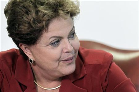 Brazil's President Dilma Rousseff reacts during a meeting with Volkswagen Brazil's President Thomas Schmall (not pictured) at the Planalto Palace in Brasilia October 3, 2013. REUTERS/Ueslei Marcelino