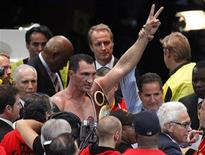 World heavyweight world champion Vladimir Klitschko (C) of Ukraine celebrates his victory over Alexander Povetkin of Russia after their heavyweight title fight in Moscow October 6, 2013. REUTERS/Maxim Shemetov