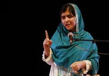 Pakistan's Malala Yousafzai gives a speech after receiving the RAW (Reach All Women) in War Anna Politkovskaya Award at the Southbank Centre in London October 4, 2013. REUTERS/Luke MacGregor