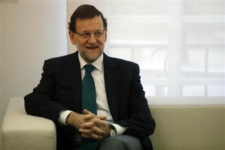 Spain's Prime Minister Mariano Rajoy smiles during a meeting with Saudi Arabia Transport Minister Jubara Al Suraisry (not pictured) at Madrid's Moncloa Palace September 27, 2013. REUTERS/Juan Medina