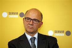 Le ministre de l'Economie et des Finances Pierre Moscovici a annoncé dimanche qu'une surtaxe sur l'impôt sur les sociétés serait introduite dans le projet de loi de finances pour 2014 en remplacement de la taxe sur l'excédent brut ou net d'exploitation qui avait été envisagée. /Photo prise le 4 octobre 2013/REUTERS/Benoît Tessier