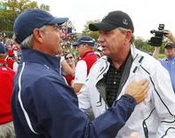 International captain Nick Price (R) congratulates U.S. captain Fred Couples after the U.S. won the 2013 Presidents Cup golf tournament at Muirfield Village Golf Club in Dublin, Ohio October 6, 2013. REUTERS/Jeff Haynes
