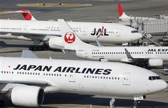 Japan Airlines aircrafts are parked on the tarmac at Haneda Airport in Tokyo February 4, 2013. REUTERS/Toru Hanai