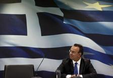Le ministre délégué aux Finances grec, Christos Staikouras. La Grèce devrait émerger l'an prochain de six ans de récession, prévoit le gouvernement dans le projet de budget présenté lundi, qui entérine l'amélioration progressive de la situation après la crise de la dette qui a contraint Athènes à accepter une mise sous tutelle internationale. /Photo prise le 7 octobre 2013/REUTERS/Yorgos Karahalis