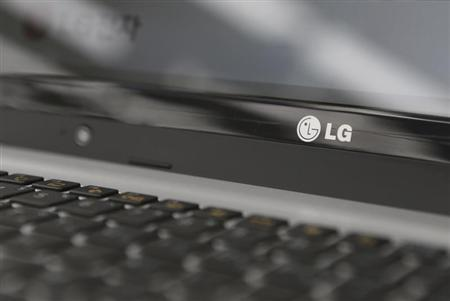 An LG Electronics' logo is pictured on a laptop computer displayed at a shop in central Seoul, July 23, 2013. REUTERS/Lee Jae-Won