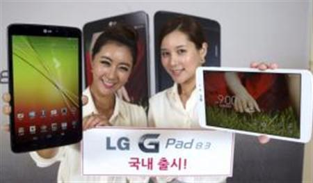 Models show the G Pad 8.3 of LG Electronics at a promotion event in Seoul in this picture released by the company October 7, 2013. REUTERS/LG Electronics/Handout via Reuters