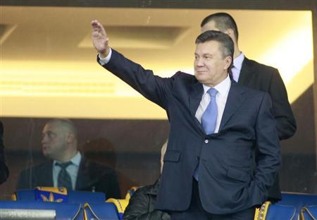 Ukrainian President Viktor Yanukovich waves before the 2014 World Cup qualifying soccer match between Ukraine and England at the Olympic stadium in Kiev September 10, 2013. REUTERS/Gleb Garanich