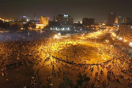 People gather in Tahrir square to celebrate the anniversary of an attack on Israeli forces during the 1973 war, in Cairo October 6, 2013. REUTERS/Mohamed Abd El Ghany