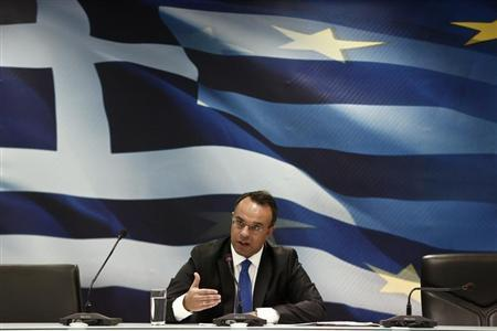Greek Deputy Finance Minister Christos Staikouras addresses reporters during a briefing at a ministry hall in Athens October 7, 2013. REUTERS/Yorgos Karahalis