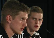 Germany's national soccer players and twins Sven (R) and Lars Bender listen during a news conference in Tourrettes, southern France, May 23, 2012. REUTERS/Ina Fassbender