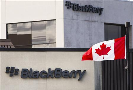 A Canadian flag waves in front of a Blackberry logo at the Blackberry campus in Waterloo, in this September 23, 2013 file photo. REUTERS/Mark Blinch/files