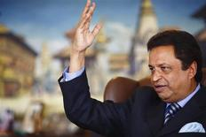 REFILED - ADDING COUNTRY BYLINE Nepal's only billionaire Binod Chaudhary, whom Forbes valued at a billion dollars in March, gestures as he speaks with Reuters during an interview at his office at Chaudhary Group in Kathmandu October 4, 2013. REUTERS/Navesh Chitrakar