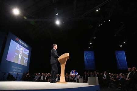 Britain's Prime Minister David Cameron delivers his keynote address to the Conservative Party annual conference in Manchester, northern England October 2, 2013. REUTERS/Oli Scarff/Pool