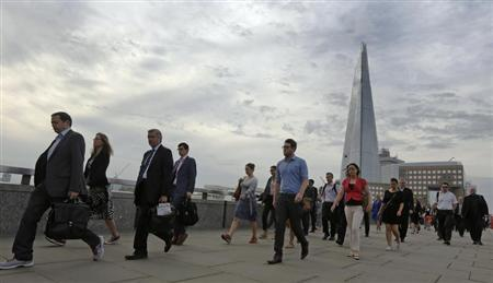 Commuters walk across London Bridge to the City of London August 7, 2013. REUTERS/Luke MacGregor