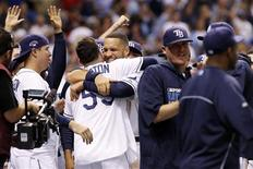 Oct 7, 2013; St. Petersburg, FL, USA; Tampa Bay Rays catcher Jose Lobaton (59) is congratulated by first baseman James Loney (middle, facing forward) after hitting a walk off home run during the ninth inning against the Boston Red Sox in game three of the American League divisional series at Tropicana Field. Kim Klement-USA TODAY Sports