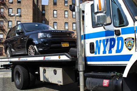 The SUV involved in Sunday's Manhattan's Henry Hudson Parkway motorcycle accident is seen on a NYPD truck arriving to the 33 precinct in New York October 4, 2013. REUTERS/Eduardo Munoz