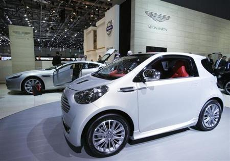 The Aston Martin Cygnet car is displayed on the exhibition stand of Aston Martin during the first media day of the 80th Geneva Car Show at the Palexpo in Geneva March 2, 2010. REUTERS/Denis Balibouse/Files