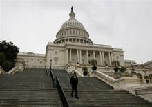 Moody's Investors Service juge très faible le risque de voir les Etats-Unis faire défaut sur leur dette au cours des prochaines semaines, selon son PDG Michel Madelain. /Photo prise le 7 octobre 2013/REUTERS/Jason Reed