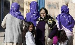 Turkish women stand near their homes in the Turkish border town of Ceylanpinar, Sanliurfa province, close to the border with Syria, November 20, 2012. REUTERS/Amr Abdallah Dalsh
