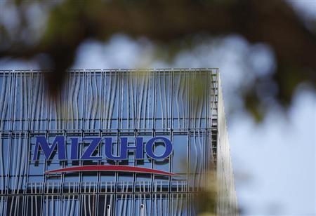 A logo of Mizuho bank, belonging to Mizuho Financial Group, is seen at its branch in Tokyo January 29, 2013. REUTERS/Shohei Miyano