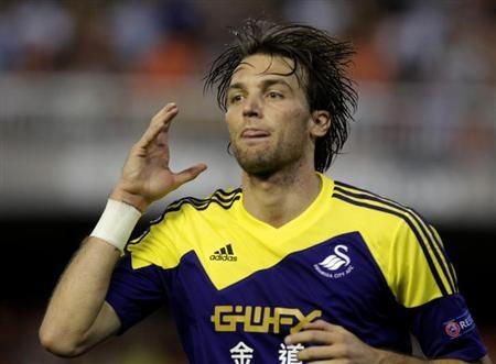 Swansea City's Michu celebrates his goal against Valencia during their Europa League soccer match at the Mestalla stadium in Valencia, September 19, 2013. REUTERS/Heino Kalis
