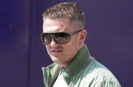 Far-right group English Defence League (EDL) leader Tommy Robinson attends a demonstration outside the Central Criminal Court (The Old Bailey) during the sentencing of six Islamic extremists in London, June 6, 2013. REUTERS/Neil Hall