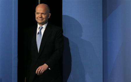 Britain's Foreign Secretary William Hague walks on stage ahead of his keynote address on the opening day of The Conservative Party annual conference in Manchester, northern England September 29, 2013. REUTERS/Phil Noble