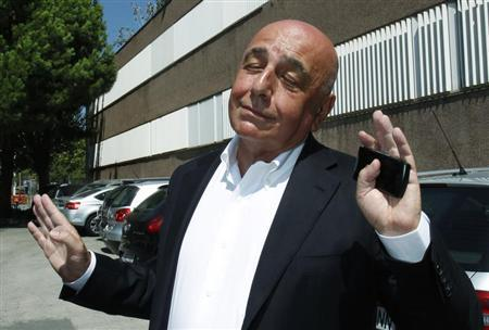 AC Milan's chief executive officer Adriano Galliani gestures as he leaves FC Barcelona's office in Barcelona August 26, 2010. REUTERS/Albert Gea