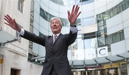 Tony Hall poses for photographers on his arrival at Broadcasting House for his first day as the new Director General of the BBC, in central London April 2, 2013. REUTERS/Andrew Winning