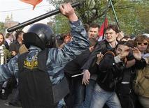 Разгон демонстрации на Болотной площади 6 мая 2012 года. Одного из ее участников - Михаила Косенко суд отправил в психиатрическую больницу на принудительное лечение, что критики сочли возвращением карательной психиатрии советского типа. REUTERS/Denis Sinyakov