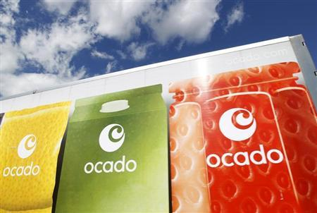 An Ocado truck returns to the Ocado depot in Hatfield, southern England July 21, 2010. REUTERS/Suzanne Plunkett
