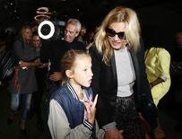 British model Kate Moss leaves the Topshop Unique Spring/Summer 2014 collection with her daughter Lila Grace during London Fashion Week September 15, 2013. REUTERS/Olivia Harris