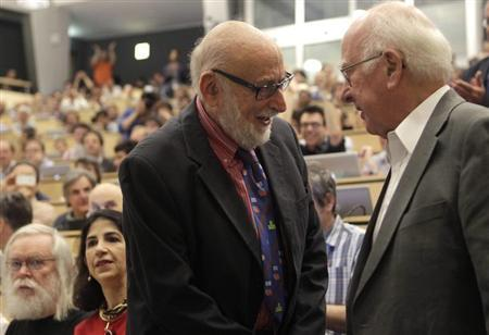 British physicist Peter Higgs (R) shakes hands with Belgium physicist Francois Englert before a scientific seminar to deliver the latest update in the search for the Higgs boson at the European Organization for Nuclear Research (CERN) in Meyrin near Geneva July 4, 2012. REUTERS/Denis Balibouse