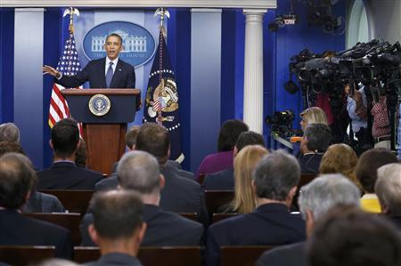 U.S. President Barack Obama speaks to reporters about the continuing government shutdown during a news conference from the White House Briefing Room in Washington, October 8, 2013. REUTERS/Kevin Lamarque