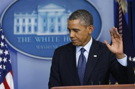U.S. President Barack Obama waves goodbye at the end of his news conference, during which he discussed the continuing government shutdown, from the White House Briefing Room in Washington, October 8, 2013. REUTERS/Kevin Lamarque
