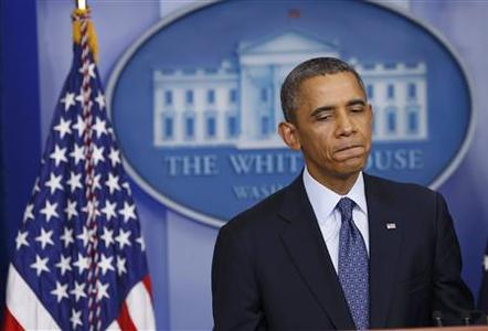 U.S. President Barack Obama pauses while speaking about the continuing government shutdown during a news conference in the White House Briefing Room in Washington, October 8, 2013. REUTERS-Kevin Lamarque