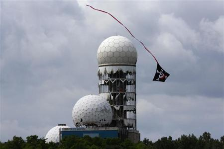 A kite flies near antennas of Former National Security Agency (NSA) listening station at the Teufelsberg hill (German for Devil's Mountain) in Berlin, June 30, 2013. REUTERS/Pawel Kopczynski
